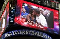 """U.S. President Obama and first lady Michelle Obama are shown kissing on the """"Kiss Cam"""" screen during a timeout in the Olympic basketball exhibition game between the U.S. and Brazil national men's teams in Washington"""